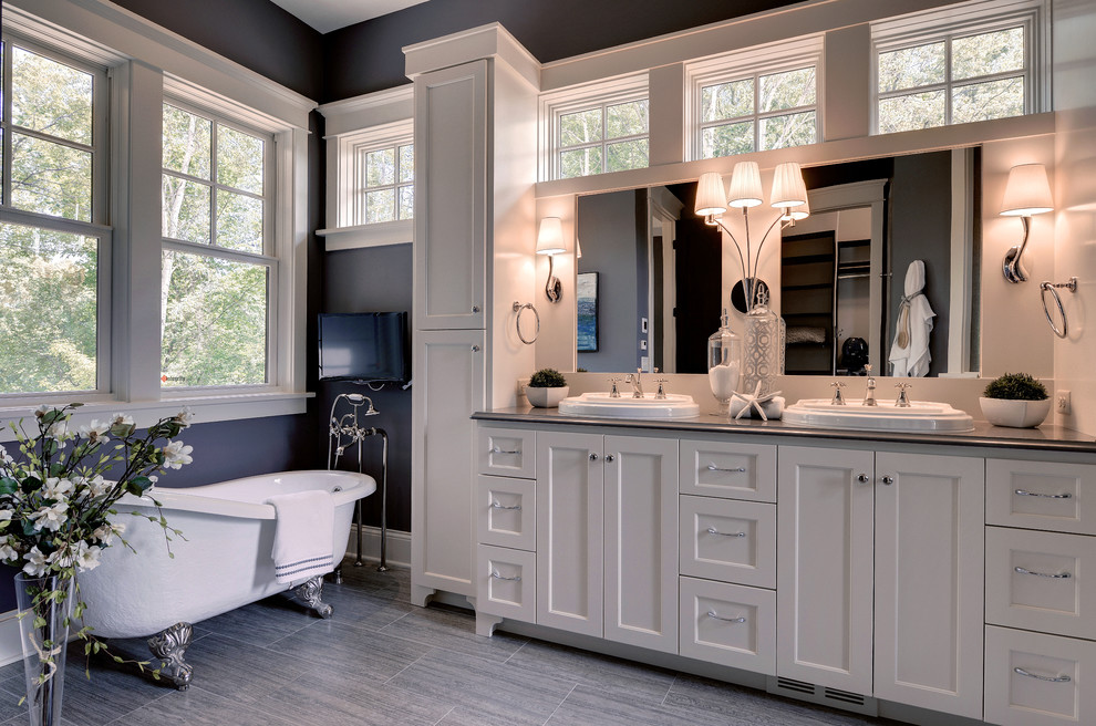 Gorgeous-Amerock-fashion-Minneapolis-Traditional-Bathroom-Image-Ideas-with-blue-painted-wall-clawfoot-tub-double-hung-windows-double-sinks-floor-mounted-faucet-freestanding